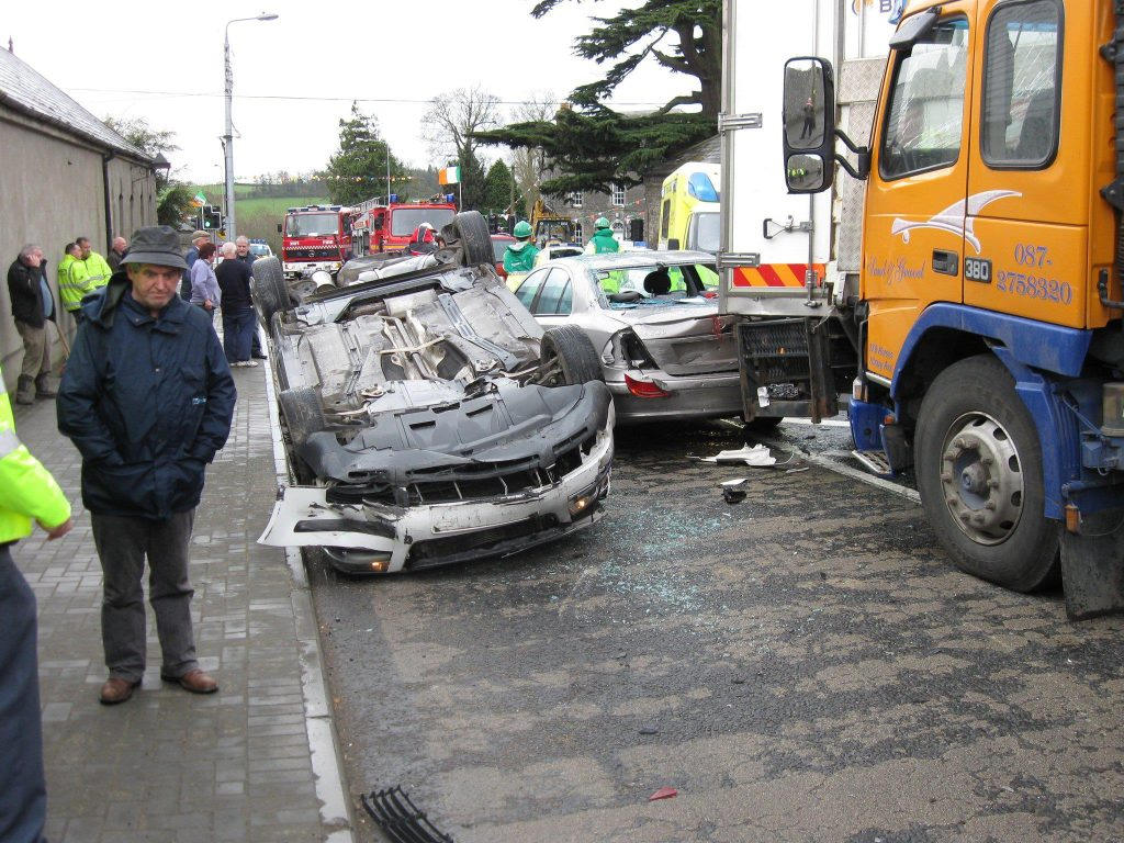 Shocked bystanders examine the devastation of a multi-vehicle pile-up in Slane village on 23rd March
